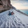 На вершине песчаной дюны пляжа Archer