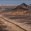 Черная пустыня - дорога среди холмов